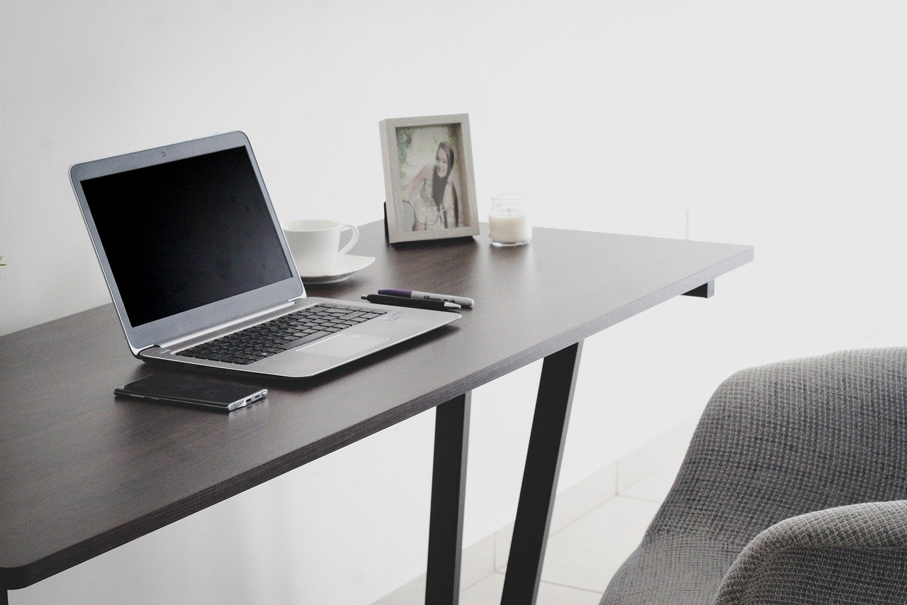 desk with laptop and chair